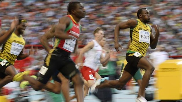 Usain Bolt of Jamaica (R) runs ahead of Antoine Adams of Saint Kitts and Nevis (2nd L) in their men's 200 metres semi-final heat during the IAAF World Athletics Championships at the Luzhniki stadium in Moscow (Reuters)