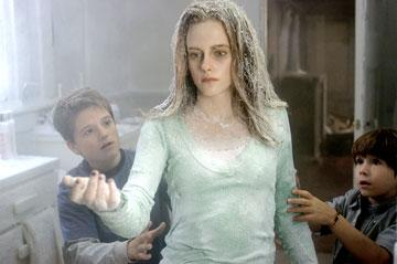 Josh Hutcherson , Kristen Stewart and Jonah Bobo in Columbia Pictures? Zathura