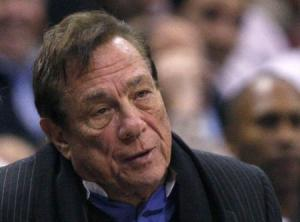 File of Clippers owner Sterling sitting as he watches team play Knicks in NBA game in Los Angeles