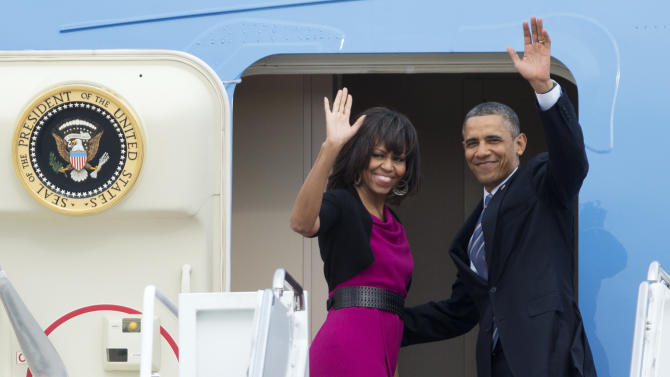 President Barack Obama and first lady Michelle Obama, wave as they leave Andrews Air Force Base, Md., for Dallas, Wednesday, April 24, 2013.  (AP Photo/Manuel Balce Ceneta)