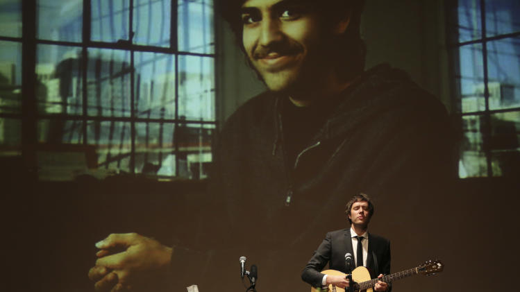Damien Kulash, of the band OK Go, perorms during the memorial service for Aaron Swartz, Saturday, Jan. 19, 2013 in New York. Friends and supporters of Aaron Swartz paid tribute Saturday to the free-information activist and online prodigy, who killed himself last week as he faced trial on hacking charges. (AP Photo/Mary Altaffer)