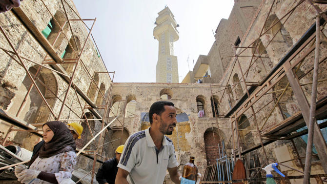 FILE -  In this Aug. 20, 2009 file photo, an Egyptian antiquities worker performs restoration work on the Ben Maimon Synagogue in Cairo, Egypt. A leading Muslim Brotherhood member and advisor to Islamist President Mohammed Morsi created a stir in Egypt when he called on Egyptian Jews living in Israel to return home because the Jewish state won't survive. The TV remarks of Essam el-Erian, a prominent Brotherhood member often jailed under the previous regime of Hosni Mubarak, put his Islamist group, now in power, on the spot on many fronts as detractors of the group, and in one incident allies, seized on the comments to criticize the group.(AP Photo/Ben Curtis, File)