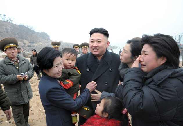 Residents greet North Korean leader Kim Jong-Un during his visit in the southwest of Pyongyang