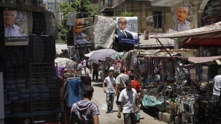 "Campaign posters supporting Egyptian presidential candidate Ahmed Shafiq, the last prime minister of deposed president Hosni Mubarak, hang above a popular market in Cairo, Egypt, Tuesday, June 12, 2012. Arabic on the banners reads: ""Ahmed Shafiq for Egyptian presidency"",  and ""Egypt for all.""(AP Photo/Amr Nabil)"