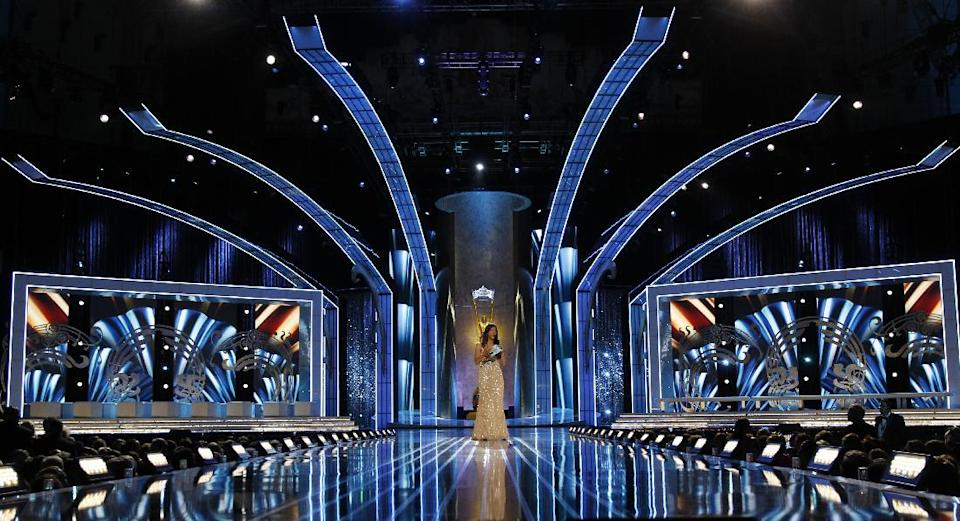 Former Miss New Jersey Ashleigh Udalovas walks on the stage before the start of the Miss America 2014 pageant, Sunday, Sept. 15, 2013, in Atlantic City, N.J. (AP Photo/Mel Evans)