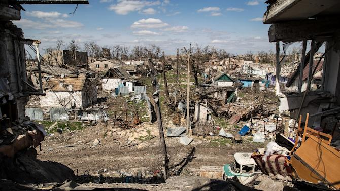Houses destroyed after shelling in the village of Peski, near Donetsk, on April 23, 2015