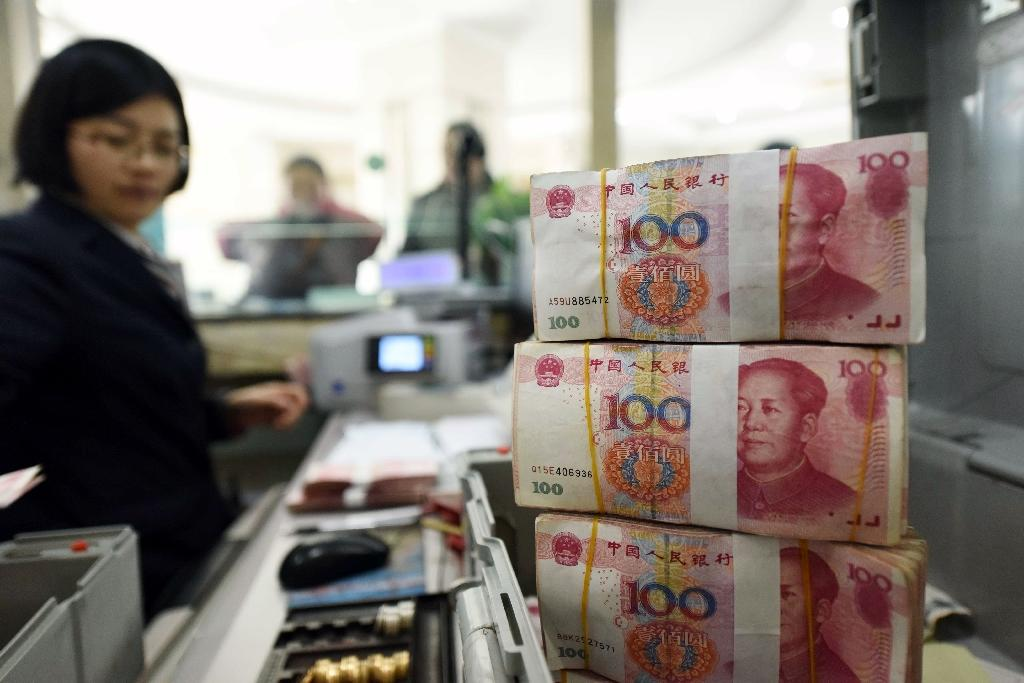 China forex reserves fall almost $100 bn in January