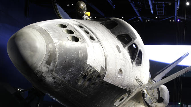 This June 20, 2013 photo shows the space shuttle Atlantis on display at the Kennedy Space Center Visitor Complex in Cape Canaveral, Fla. The 900,000 square-foot facility centering around the last shuttle to go into orbit will open to the public June 29. (AP Photo/John Raoux)