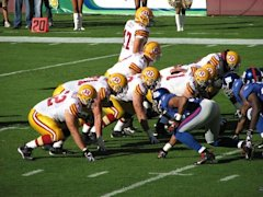 800px-Redskins_vs_Giants_line_of_scrimmage_throwbacks