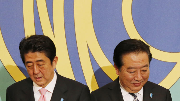 FILE - In this Nov. 30, 2012 file photo, Japanese Prime Minister Yoshihiko Noda, right, of Japan's ruling Democratic Party of Japan, and main opposition Liberal Democratic Party leader Shinzo Abe attend a debate by party leaders for the upcoming lower house elections in Tokyo. Leaders for Japan's biggest political parties kicked off Tuesday, Dec. 4 the campaign for parliamentary elections to be held in less than two weeks with visits to nuclear crisis-hit Fukushima prefecture. (AP Photo/Koji Sasahara, File)