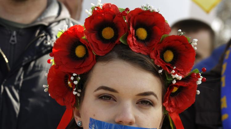 Woman with her mouth taped over attends pro-Ukraine rally in Simferopol