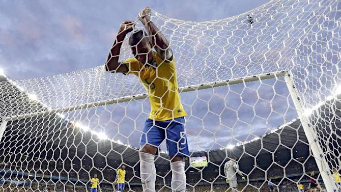 In this Tuesday, July 8, 2014 file photo, Brazil's Fernandinho reacts after Germany's Toni Kroos scored his side's third goal during the World Cup semifinal soccer match between Brazil and Germany at the Mineirao Stadium in Belo Horizonte, Brazil. Deprived of the injured Neymar, host nation Brazil was routed 7-1 by Germany. Remarkably Germany was 5-0 ahead against the 5-time World Cup winners within the first half hour. A few days later, Germany defeated Argentina 1-0, with a late strike from Mario Goetze, to claim its fourth World Cup