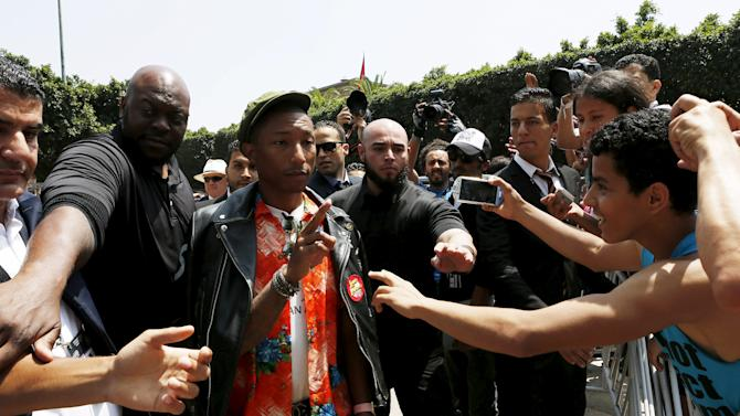 Singer Pharrell Williams arrives for the photocall at the 14th Mawazine World Rhythms International Music Festival in Rabat