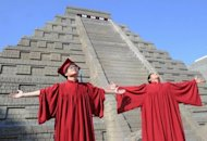 <p>Students celebrate their graduation in front of a replica Mayan pyramid before a countdown by Taiwan's National Museum of Natural Science to help reassure the public it is not the end of the world, in Taichung on December 21, 2012. A global day of lighthearted doom-themed celebration culminated Friday in the jungle temples of the Mayan people of Central America, whose calendar sparks apocalypse fears.</p>