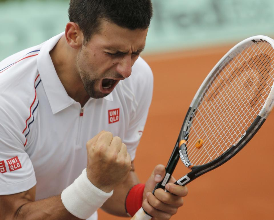 Novak Djokovic of Serbia celebrates winning his quarter final match against Jo-Wilfried Tsonga of France at the French Open tennis tournament in Roland Garros stadium in Paris, Tuesday June 5, 2012. Djokovic won in five sets 6-1, 5-7, 5-7, 7-6, 6-1. (AP Photo/Christophe Ena)