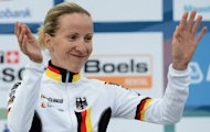 Germany 's gold medalist Judith Arndt celebrates on the podium of the women's Elite Time Trial at the UCI Road World Championships in Valkenburg. Arndt retained her women's time-trial title at the cycling world road championships