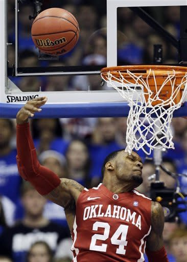 McLemore leads No. 3 Kansas past Oklahoma, 67-54