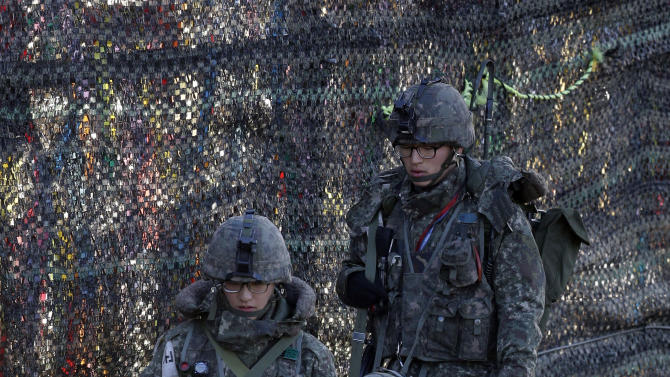 """South Korean soldiers patrol through their military fences near the border village of Panmunjom, that has separated the two Koreas since the Korean War, in Paju, north of Seoul, South Korea, Sunday, April 14, 2013. North Korea on Sunday rebuffed a South Korean proposal to resolve rising tensions through dialogue, dismissing it as a """"crafty trick"""" by the rival. (AP Photo/Lee Jin-man)"""