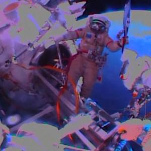 Cosmonauts take Sochi Olympic torch on spacewalk