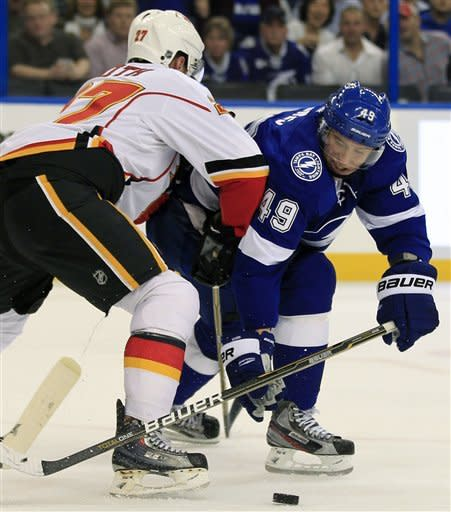 Stamkos scores in OT to lift Lightning over Flames