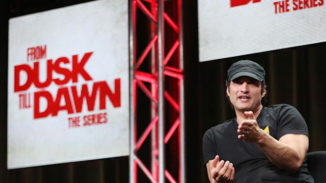"""IMAGE DISTRIBUTED FOR EL REY NETWORK - Creator, executive producer, and director Robert Rodriguez is seen during the El Rey Network """"From Dusk Till Dawn: The Series"""" panel during the 2015 Summer TCA in Beverly Hills, Calif. on Thursday, July 30, 2015. (Photo by Matt Sayles/Invision for El Rey Network/AP Images)"""