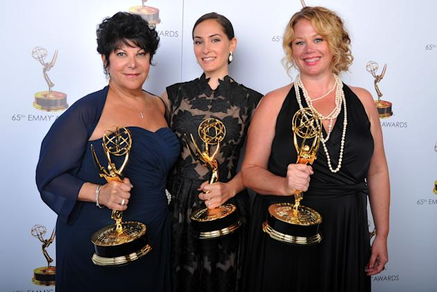 From left, Francesca Paris, Lisa Dellechiaie, and Sarah Stamp pose for a portrait at the 2013 Primetime Creative Arts Emmy Awards, on Sunday, September 15, 2013 at Nokia Theatre L.A. Live, in Los Ange