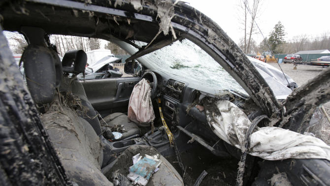 This Monday, March 11, 2013 photo in Southington, Ohio shows the interior of a vehicle where six people died in a crash early Sunday in Warren, Ohio. Two teens who escaped the crash that killed six friends in a swampy pond wriggled out of the wreckage by smashing a rear window and swimming away from the SUV, a state trooper said Monday. (AP Photo/Tony Dejak)