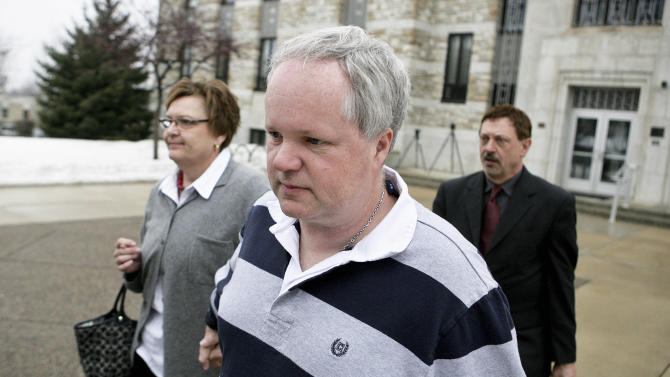 FILE - In this Feb. 17, 2011, file photo, William Melchert-Dinkel, center, leaves the Rice County Courthouse with his attorney Terry Watkins, right, and wife, Joyce Melchert-Dinkel, after waiving his right to a jury trial, in Faribault, Minn. The Minnesota Supreme Court is expected to rule Wednesday, March 19, 2014, in the case of Melchert-Dinkel, a former nurse who was convicted of going online and encouraging two people to kill themselves. Melchert-Dinkel has argued that the state's statute on aiding suicides is too broad, and his actions amounted to protected speech. (AP Photo/Robb Long, File)