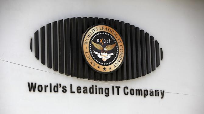 The logo of Pakistani software company Axact is seen on its office wall in Karachi