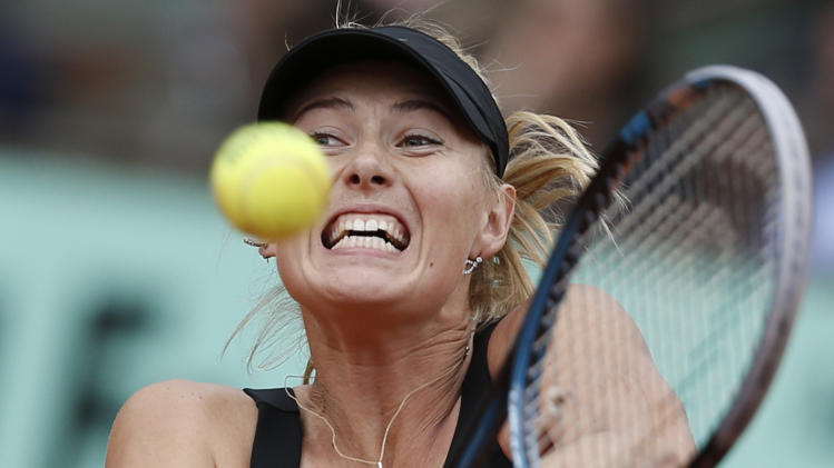 Maria Sharapova of Russia returns in the women's final match against Sara Errani of Italy at the French Open tennis tournament in Roland Garros stadium in Paris, Saturday June 9, 2012. (AP Photo/Bernat Armangue)