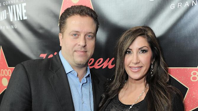 "FILE - This Nov. 30, 2012 file photo originally released by Walgreens shows Chris Laurita, left, and his wife Jacqueline Laurita, of ""The Real Housewives of New Jersey,"" at Walgreens 8000th Store Opening in Los Angeles. A Paramus man claims Jacqueline and Christopher Laurita and Giuseppe ""Joe"" Gorga attacked him as cameras rolled in a hair salon in Ridgewood on Saturday, March 30. John Karagiorgis filed a complaint, accusing the three of simple assault and making terroristic threats. The reality stars responded with their own complaints. (AP Photo/Walgreens, Jordan Strauss, file)"