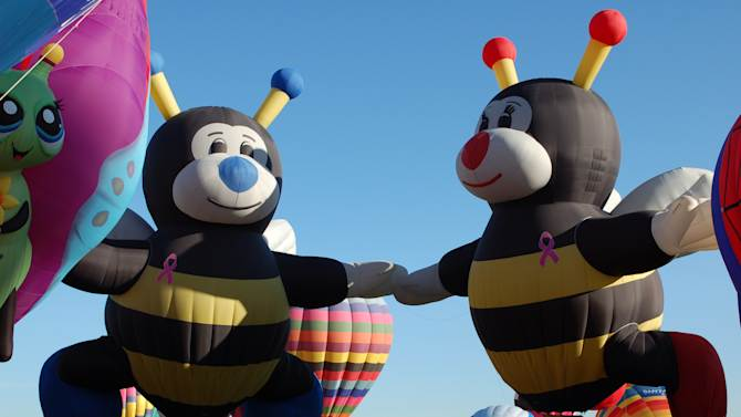 """In this Oct. 8, 2011 photo, """"Joey Little Bee"""" and """"Lilly Little Bee"""" hot air balloons are shown at the Albuquerque International Balloon Fiesta. The 41st annual event is set to begin Saturday and is expected to draw hundreds of thousands of spectators from around the country and the global. (AP Photo/Russell Contreras)"""