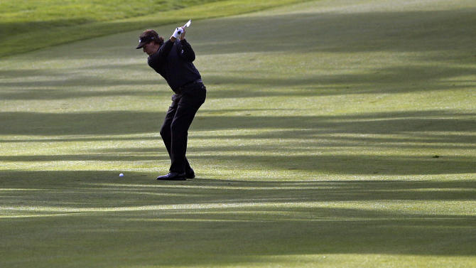 Phil Mickelson hits from the ninth fairway during the first round of the U.S. Open Championship golf tournament Thursday, June 14, 2012, at The Olympic Club in San Francisco. (AP Photo/Eric Risberg)
