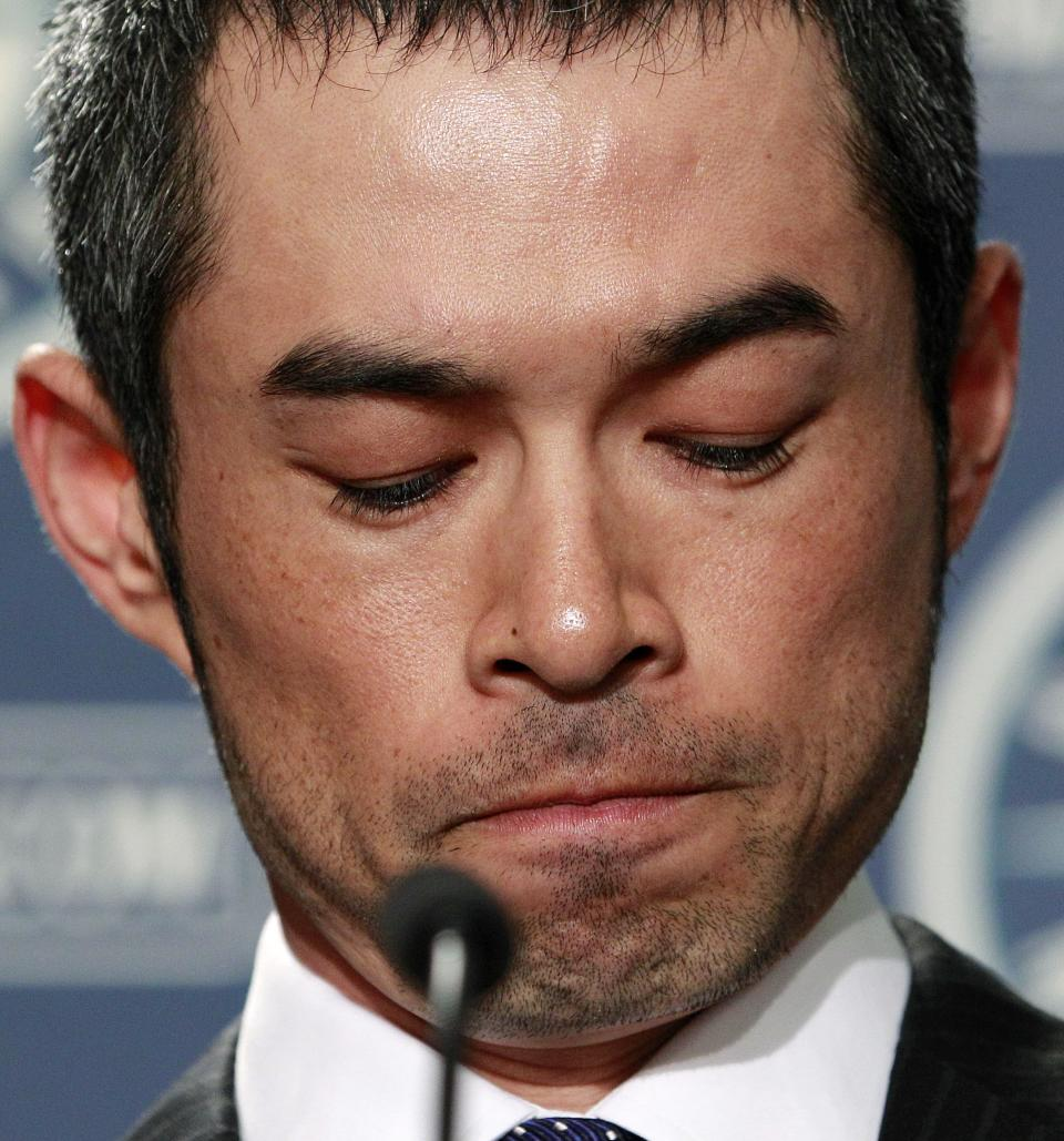 New York Yankees' Ichiro Suzuki looks down at the start of a news conference, Monday, July 23, 2012, in Seattle. The Seattle Mariners announced shortly before the news conference that Suzuki, who has played with the Mariners since 2001, was traded to the Yankees. (AP Photo/Elaine Thompson)