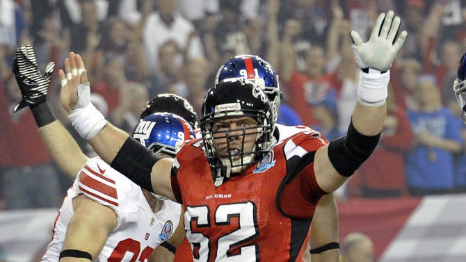 Atlanta Falcons center Todd McClure (62) celebrates as Falcons running back Michael Turner (33) runs into the end zone before the first half of an NFL football game against New York Giants, Sunday, Dec. 16, 2012, in Atlanta. (AP Photo/John Amis)