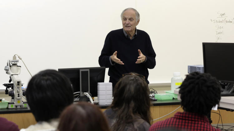 "FILE - In this April 26, 2013 file photo, actor and sometimes science professor Alan Alda addresses a Communicating Science class on the campus of Stony Brook University, on New York's Long Island. Alan Alda is now posing the question ""How do you explain color to an 11-year-old?,"" to scientists around the world. It's part of a contest he started three years ago called the ""Flame Challenge,"" to encourage scientists to find better ways of clearly explaining how science works to the general public. (AP Photo/Richard Drew, File)"