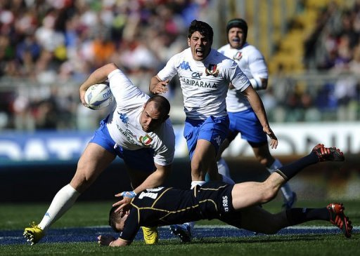 Italy's Tommaso D'Apice (C) is tackled by Scotland's Greig Laidlaw
