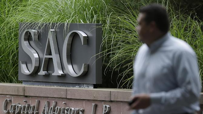 A sign is displayed in front of SAC Capital Advisors headquarters in Stamford, Conn., Thursday, July 25, 2013. The hedge fund operated by embattled billionaire Steven A. Cohen was hit with white-collar criminal charges Thursday that accused the fund of making hundreds of millions of dollars illegally, and a related government lawsuit said insider trading was pervasive and unprecedented at the firm. (AP Photo/Seth Wenig)