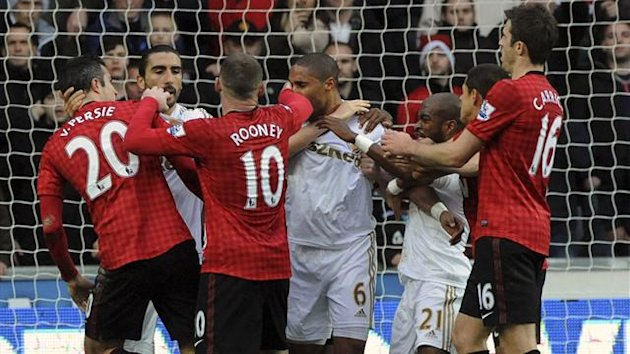 Robin van Persie and Ashley Williams clash after the incident (Reuters)