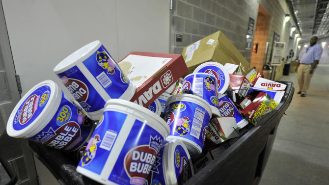 FILE - In this Sunday Oct. 24, 2010, file photo, a garbage bin sits full of bubble gum, at Yankee Stadium, in New York. U.S. gum sales tumbled 11 percent over the past four years. (AP Photo/Kathy Kmonicek, File)
