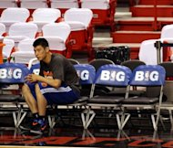 Jeremy Lin of the New York Knicks, seen here watching teammates warming up prior to his team taking on the Miami Heat in Game Five of the Eastern Conference Quarterfinals in the 2012 NBA Playoffs, on May 9, at the American Airines Arena in Miami, Florida. Lin, whose breakout season with the Knicks was cut short by injury, will return for the team next season, Knicks coach Mike Woodson says