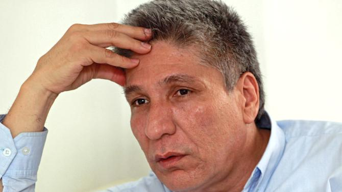 In this Aug. 30, 2012 photo, former regional lawmaker Sigifredo Lopez gestures during an interview at his home in Cali, Colombia.  Prosecutors ordered Lopez freed from house arrest on Aug. 14, three months after ordering him jailed for allegedly helping leftist rebels plan the kidnapping of 11 colleagues who were later killed. Lopez had also been kidnapped by rebels of the Revolutionary Armed Forces of Colombia, FARC, in the 2002 raid on the regional assembly in Cali. (AP Photo/Juan Bautista Diaz)