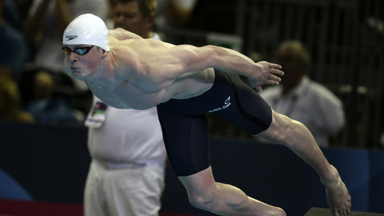 Britain's Adam Peaty starts as he is winning the gold medal and setting a new world record after the men's 50m breaststroke final at the LEN Swimming European Championships in Berlin, Germany, Friday, Aug. 22, 2014. (AP Photo/Michael Sohn)
