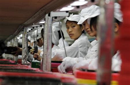 File picture shows workers inside a Foxconn factory in the township of Longhua in the southern Guangdong province