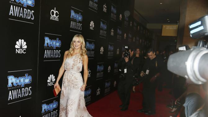 Actress Kate Hudson arrives at the People Magazine Awards in Beverly Hills