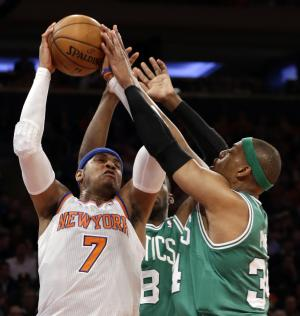 New York Knicks forward Carmelo Anthony (7) fends off Boston Celtics guard Jason Terry (8) and forward Paul Pierce, right, during the first half of Game 1 in the first round of the NBA basketball playoffs at Madison Square Garden in New York, Saturday, April 20, 2013.  (AP Photo/Kathy Willens)