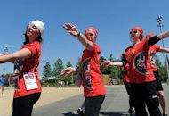 Volunteers enact Olympic sporting events at the Olympic Stadium in London on July 24. A 70,000-strong volunteer army from across the globe is helping to put on the 2012 Olympics, giving up their free time or holidays in return for a part in the biggest show on Earth