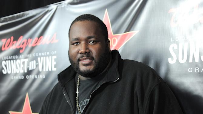 Quinton Aaron attends Walgreens 8000th Store Opening, on Friday Nov. 30, 2012, in Los Angeles. (Photo by Jordan Strauss/Invision for Walgreens/AP Images)