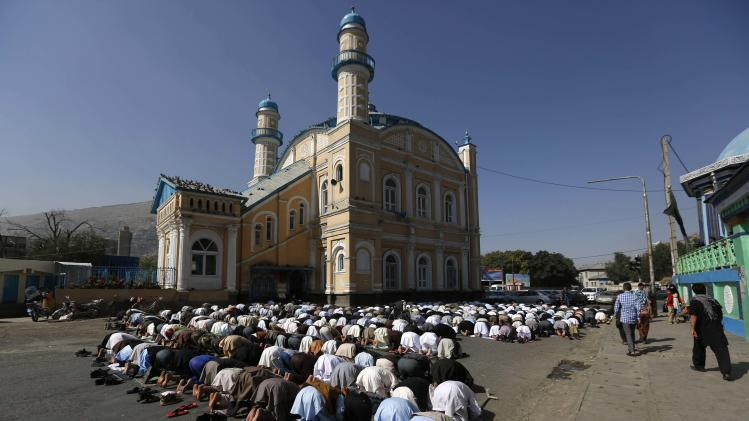 Afghans take part in morning prayers on Eid-al-Fitr outside the Shah-e Doh Shamshira mosque in Kabul