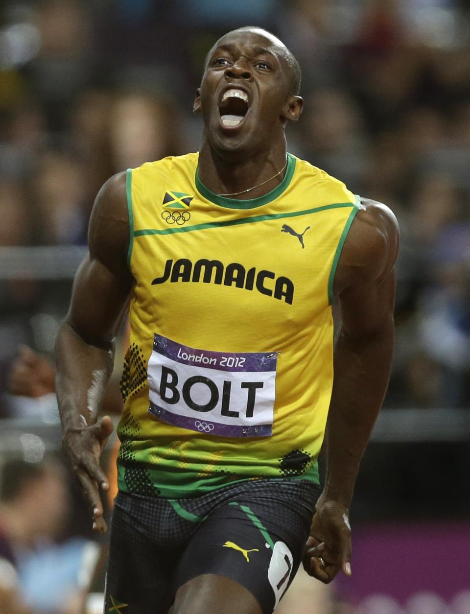 Jamaica's Usain Bolt celebrates after winning the men's 100-meter final race during the athletics competition in the Olympic Stadium at the 2012 Summer Olympics, London, Sunday, Aug. 5, 2012. (AP Photo/Marcio Jose Sanchez)